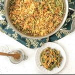 white plate with green bean casserole and text overlay