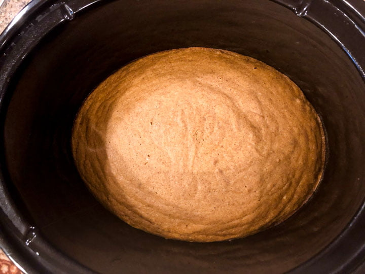 black slow cooker crock with cooked low carb pumpkin cake