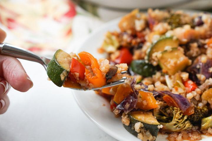 forkful of slow cooker stir fry vegetables