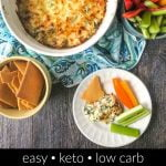 white baking dish with hot keto cream cheese dip with chicken and text overlay