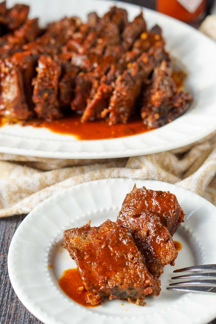 white platter with slow cooker beef roast with low carb bbq sauce