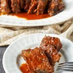 platter of slow cooker bbq beef roast with low carb bbq sauce and text