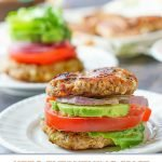 two keto everything spice turkey burgers with healthy toppings and text