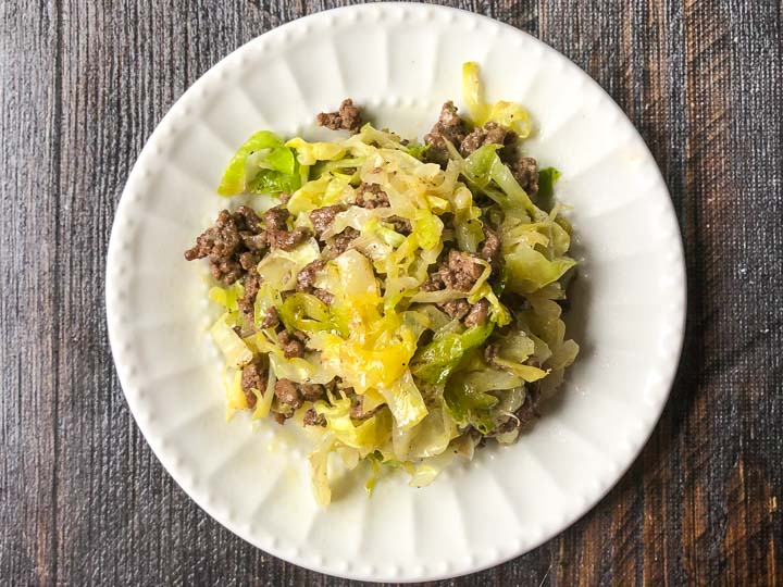 closeup of a white plate of Middle Eastern ground beef and cabbage