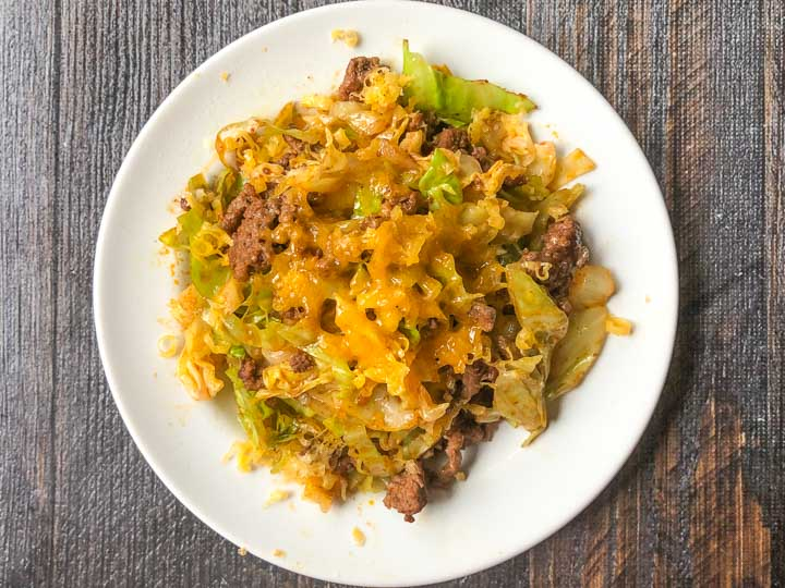closeup of a white plate of Mexican ground beef and cabbage