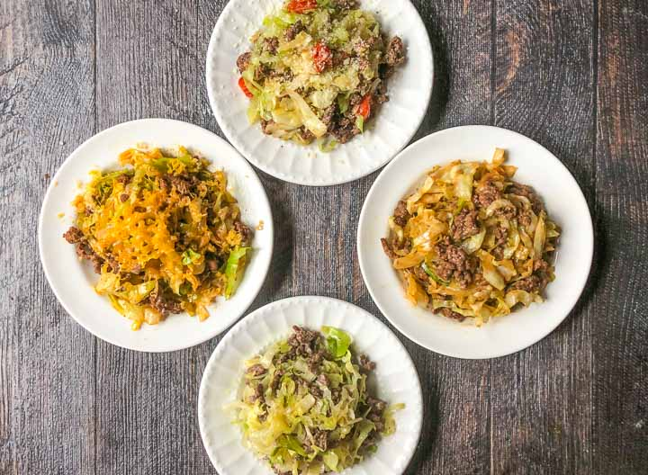 4 white plates with 4 different flavors of ground beed and cabbage low carb dinner