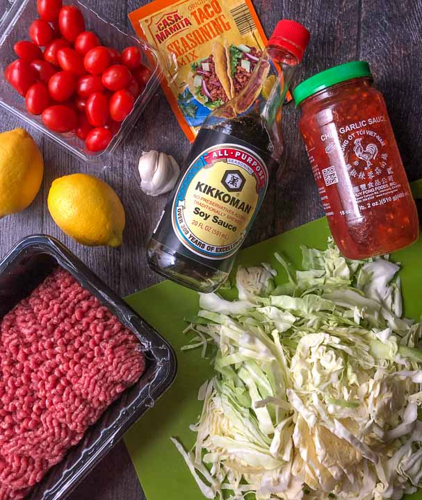 ground beef and cabbage ingredients to make various flavors: grape tomatoes, lemons, garlic, soy sauce, chili garlic sauce, taco seasoning, cabbage and ground beef