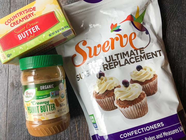 ingredients for low carb peanut butter fudge: butter, unsweetened natural peanut butter and Swerve confectioners sweetener