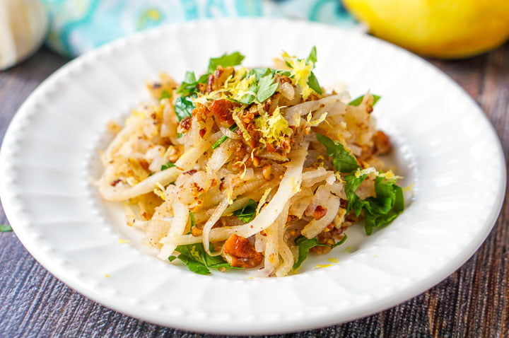 white plate of the low carb veggie noodles with pecan crumb topping