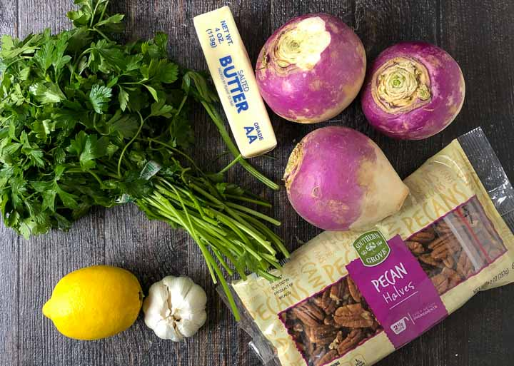 ingredients for lemon garlic turnip noodles: fresh turnip, parsley, a lemon, garlic cloves, butter and pecans
