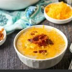 white bowls of keto cheeseburger soup with cheese and bacon and text