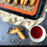 cookie sheet with keto chocolate chip biscotti and text