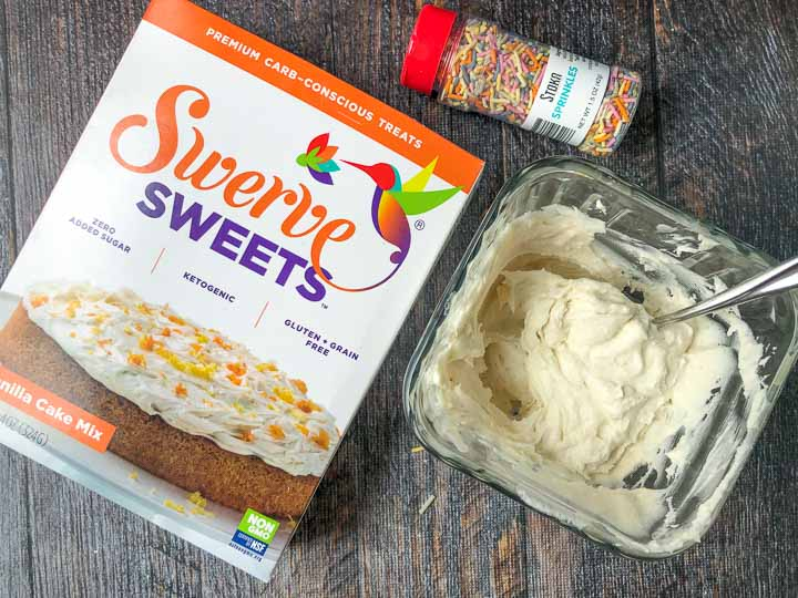sugar free Swerve box of cake and sugar free sprinkles and keto icing in a glass jar