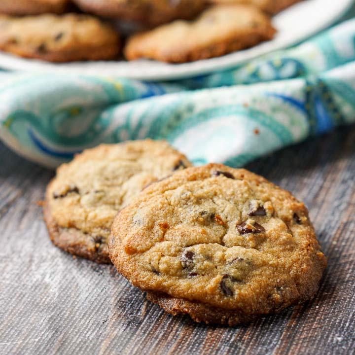 closeup of keto chocolate chip cookies with blue paisley tea towel