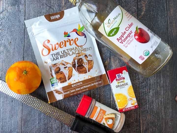 ingredients for sugar free ham glaze: orange, Swerve brown sugar, apple cider vinegar, orange extract and pumpkin spice