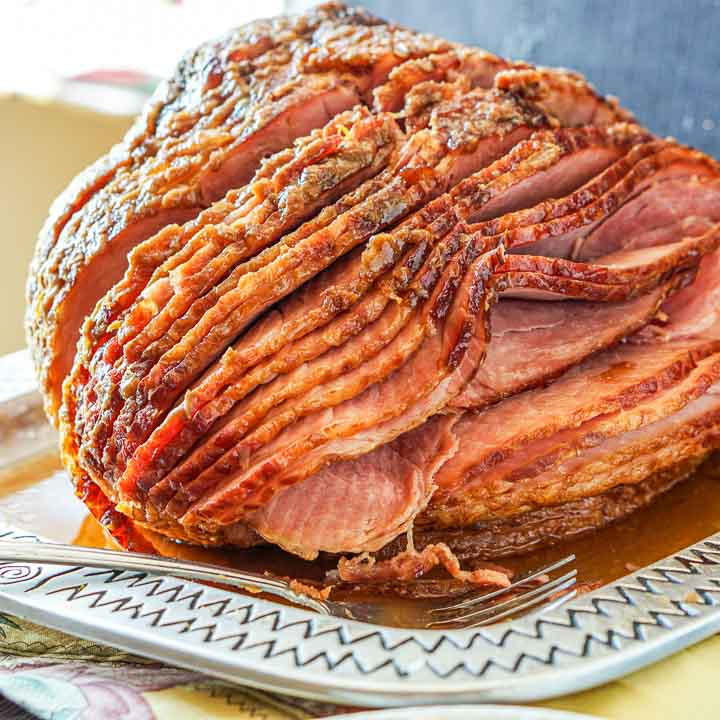 A spiral sliced ham with sugar free glaze on a silver platter