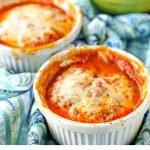 white ramekins with microwaveable mini zucchini lasagna with text