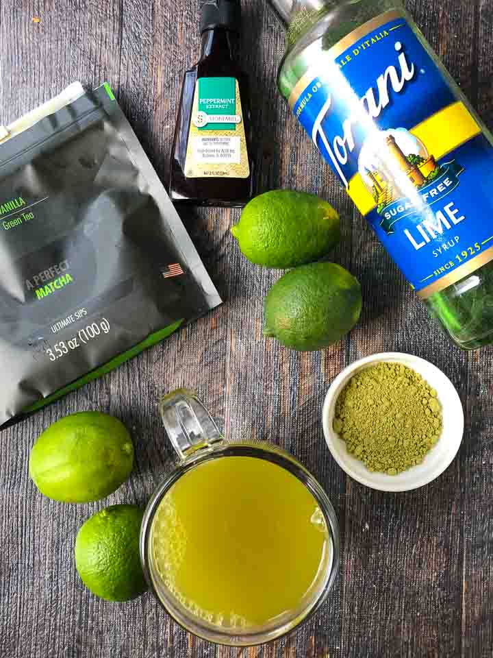 ingredients to make a hot mojito green tea drink: matcha powder, fresh limes, Torani sugar free lime syrup and peppermint extract