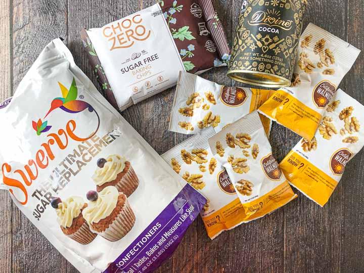 ingredients for keto fudge: California walnuts, Divine cocoa powder, Swerve sweetener and ChocZero chocolate chips