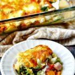 glass baking dish with low carb creamy vegetable & ham casserole and text