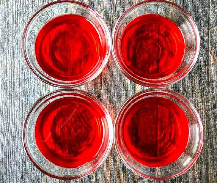 four glass bowls with sugar free strawberry jello