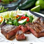 plate with cut steak and salad and text