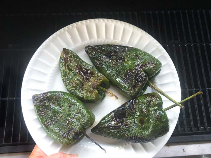 white plate with 4 grilled poblanos