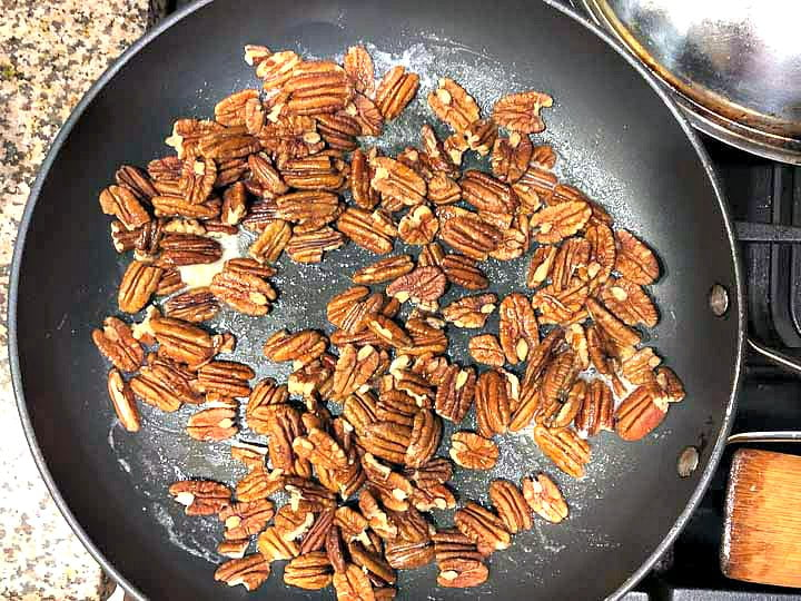 large non stick skillet with toasting pecan halves