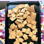 cookie sheet with keto peanut crackers and berry cream cheese and text