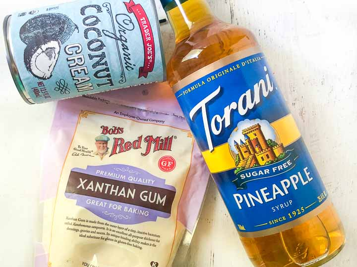 ingredients to make a keto pina colada popsicle: coconut cream, Torani sugar free pineapple syrup and xanthan gum