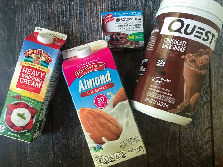 ingredients to make chocolate pudding pops: heavy cream, almond milk, chocolate sugar free pudding and Quest chocolate protein powder