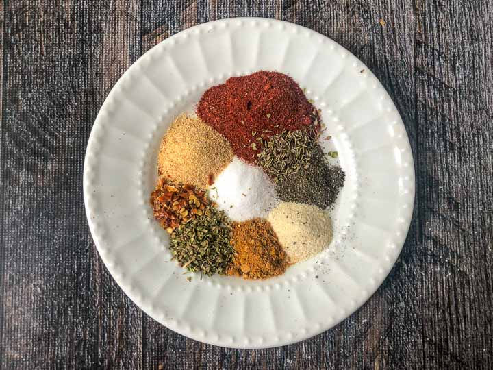 white plate with cajun spices on it