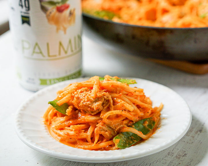 plate of red pepper pasta and a can of Palmini noodles in the background