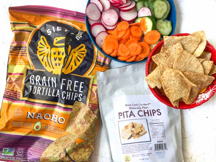 bag of grain free tortilla chips, low carb pita chips and raw vegetables