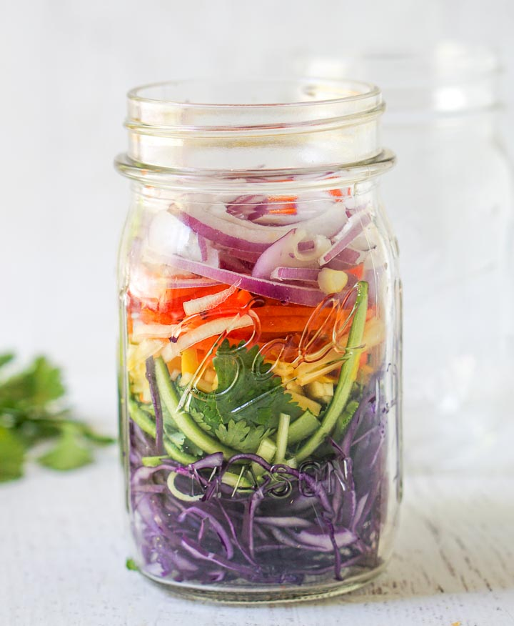 glass mason jar with the rainbow vegetables all chopped up