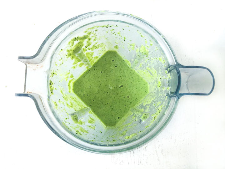 blender container with the pureed broccoli soup