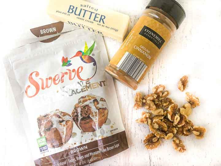 bag of Swerve brown sugar sweetener, stick of butter, bottle of cinnamon, raw walnuts
