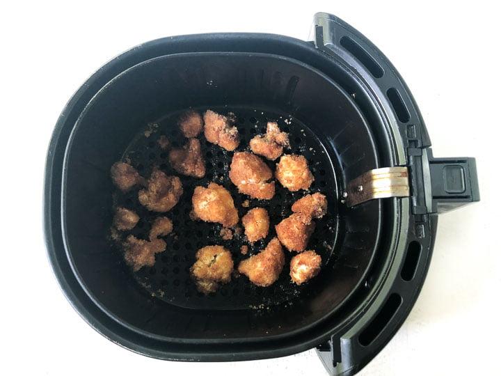 air fryer basket with fried cauliflower