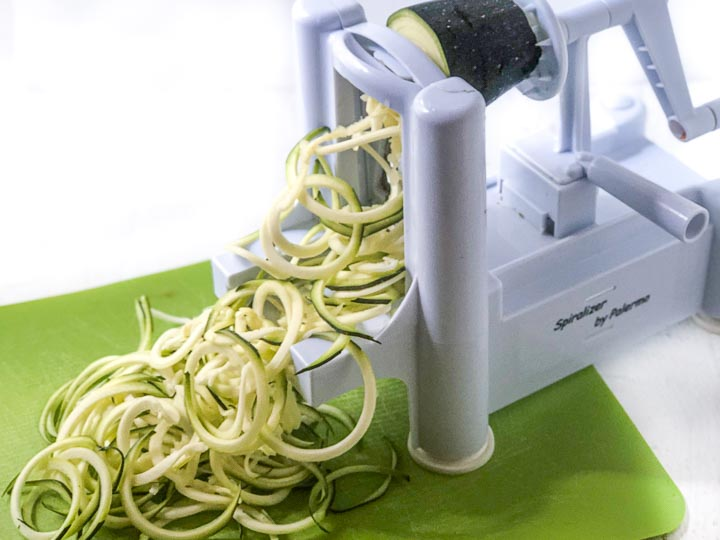 Paderno serializer making zucchini noodles on a green mat