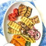 platter and dish with grilled vegetables with garlic tahini sauce and text