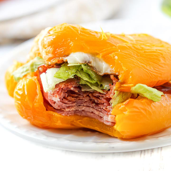 closeup of a keto bell pepper sub sandwich on white plate