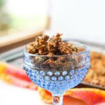 blue dish with keto granola with a bright towel and text overlay