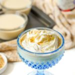 blue dessert dish with keto peanut butter banana pudding with whipped cream and text overlay
