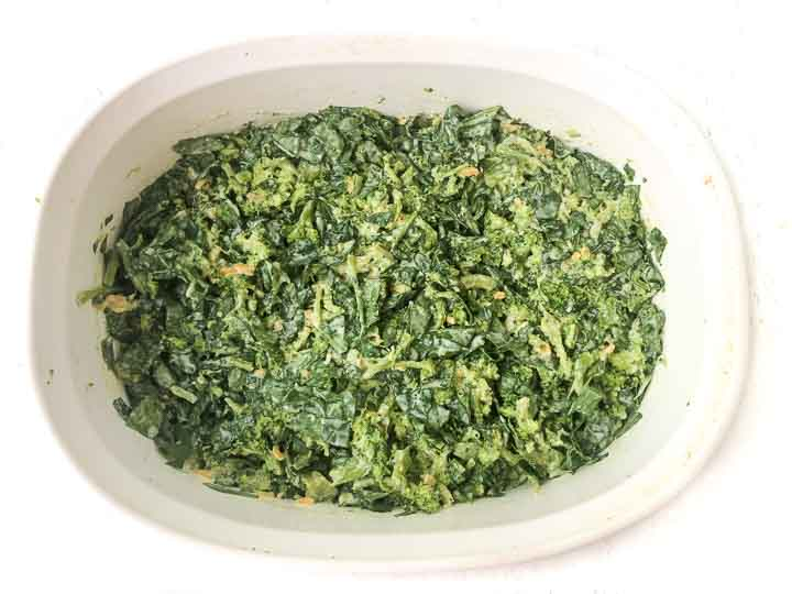 white baking dish with chopped broccoli and spinach