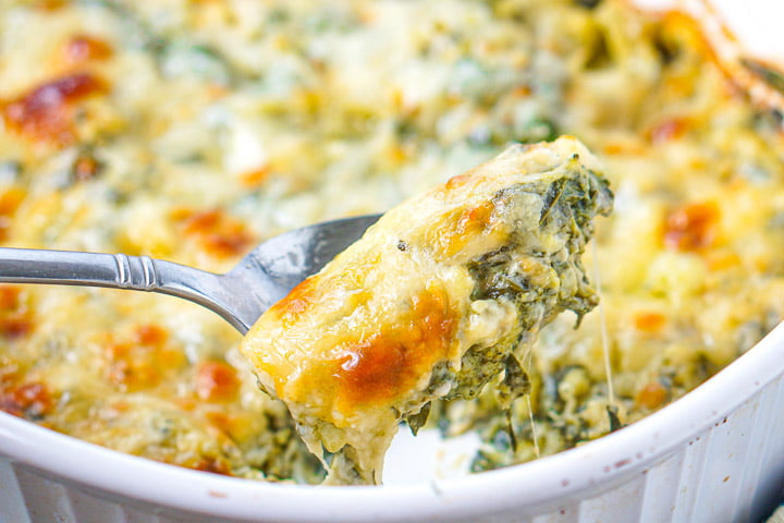 closeup of spoonful of keto spinach broccoli cheese casserole