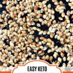 cookie sheet with everything spice keto roasted pumpkin seeds and text