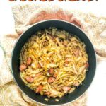 skillet with keto kielbasa and cabbage skillet and text overlay