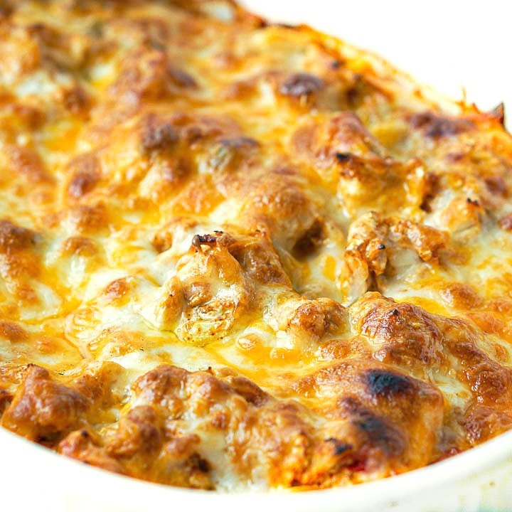 closeup of a baking dish full of keto Mexican chicken casserole with lots of browned cheese on top