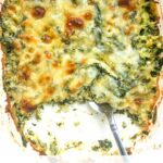white baking dish with keto spinach & broccoli cheese casserole with text overlay