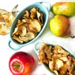 blue dishes with apple and pear chips made in the air fryer and fresh apples and pears with text